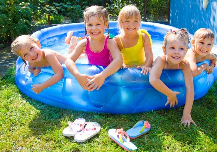 Kids happy with inflatable swimming pool