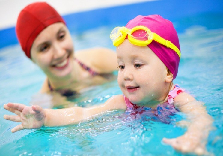 Mother teach baby swimming