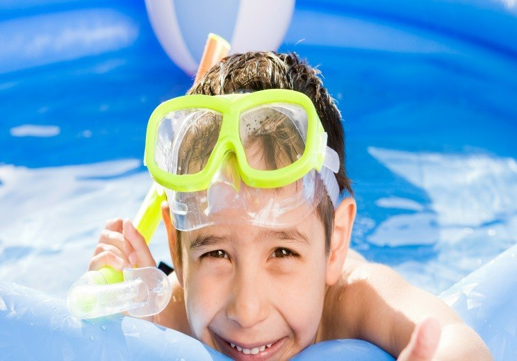 a boy play with inflatable pool
