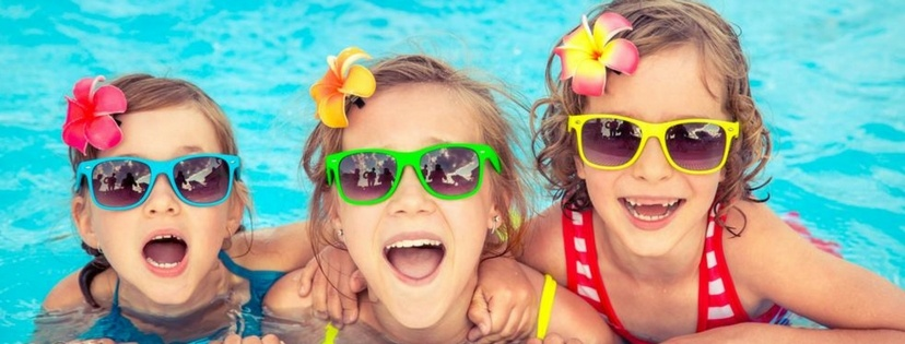 children happy in the swimming pool