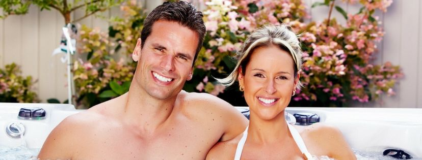 Happy couple relax clean hot tub