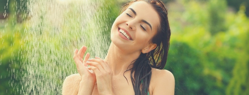 A beautiful girl happy with shower time